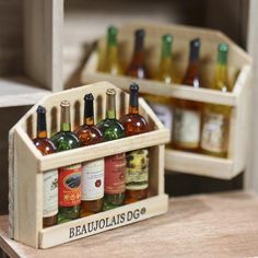 Dollhouse Miniature Wine Rack - even though this has a magnet on the back, that could be removed and this could be displayed in a restaurant or shop scene.  Possibly,  it could be displayed in a cellar scene as well!!