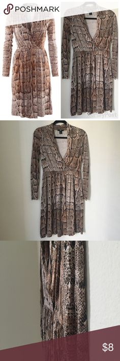 H&M Snake skin print faux wrap dress H&M snakeskin faux wrap dress; knee length  Color: cream/beige & black; snake skin print python  Size: small Material: 100% viscose  Condition: used; small hole near back right shoulder, unnoticeable (see pics) due to print   Made in Cambodia H&M Dresses Midi