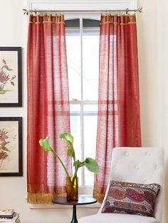 No-Sew DIY Curtains: Made from shawls found for $8 each, these panels are an inexpensive alternative to custom window treatments. Cut away the fringe from one end of each shawl and hot-glue decorative trim along the raw end. Hang from clip rings.