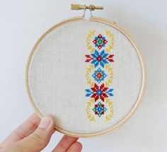 Ukrainian ornament hand embroidery cross stitch in wooden hoop