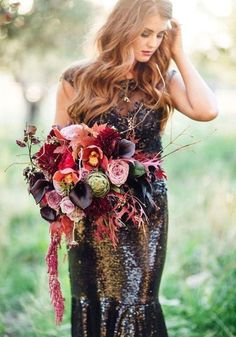 glamorous, dark colours in this boho glam wedding bouquet