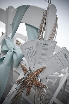 <3 The wedding programs, starfish, & chair sashes look so pretty. I love the color. Perfect for a beach wedding. It looks like there is a tiny bubble wand necklace handing off the chair as well. AMAZING!!! <3 {Wedding Ideas} {Photography} {Garden Wedding}