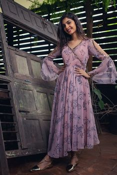 Beautiful Printed Chiffon-Silk Kurti with hand embroidery embellishment. Modern silhouette with traditional embellishments create sober design Indian Designer Outfits, Indian Outfits, Designer Dresses, Designer Kurtis, Kurta Designs Women, Blouse Designs, Latest Kurti Designs, Printed Kurti Designs, Silk Kurti Designs
