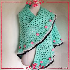 Lovely shawl made with the granny stitch and little crochet flowers