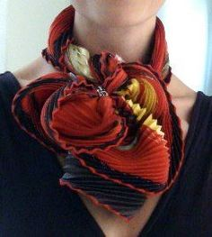 Lots of info to tie scarves at this blog.