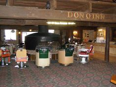 """Hotel """"Don Q Inn """", Dodgeville, Wisconsin, USA. You've got to see it to believe it.  Yes, those are old barber chairs around the fireplace. No, we did not stay there."""