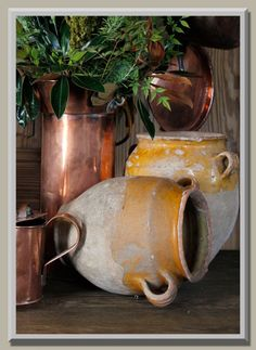One of the most recognized symbols of classic Country French gourmet décor, antique confit pot didn't start out to be an element of aesthetic design.  For centuries the French used the brightly colored earthenware pots for daily storage of duck or goose confits.