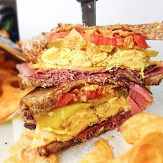 Zesty egg sandwiches made with whole wheat bread, pastrami, scrambled egg, colby jack cheese, zesty pickles, tomatoes, and kettle chips!