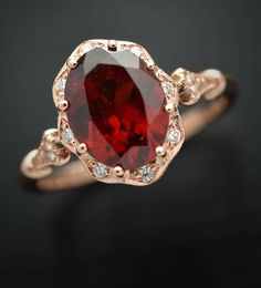 Oval Engagement ring Red Natural Garnet in yellow Pink with flower halo and and accent diamonds - eheringe Oval Halo Engagement Ring, Vintage Inspired Engagement Rings, Art Amour, Garnet Rings, Ruby Rings, Garnet Jewelry, Gold Ruby Ring, Garnet Wedding Rings, Dainty Jewelry
