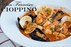 Seafood stew originating from San Francisco, flavorful and tasty tomato based soup with clams, mussels, crab, shrimp, squid, fish, and scallops.