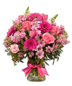"""Charmed - She will indeed be """"charmed"""" when she receives this awesome bouquet in luxurious shades of pink. This tall, elegant bouquet includes flowers like roses, stock, snap dragons, gerbers, alstromeria and more. Nationwide Delivery"""
