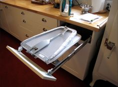 This hack makes hiding an ironing board on the back of a door look like amateur hour. Even better? It rolls completely out of sight when not in use so you can use this hack in your laundry room or even your bedroom without ruining the decor. See more from Flickr user litlnemo »