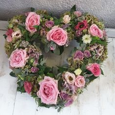 'Loose' floral open heart in #Roses, #Hydrangeas, #Lisianthus, #Astrantia, #Heather and soft foliage leaves. Florist London, Funeral Tributes, Astrantia, Same Day Flower Delivery, Hydrangeas, Floral Wreath, Roses, Leaves, Seasons