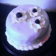 Lemon and raspberry cake, with fondant, buttercream, and blueberries. Measuring just 4in. Perfect personal size.