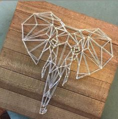 Geometric elephant string art on a wood that is ready to be hung up. Has a long string attached to … String Art Diy, Diy Wall Art, Wood Wall Art, String Art Templates, String Art Patterns, Geometric Elephant, Elephant Art, Light Wall Art, Thread Art