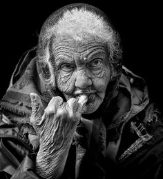 Old lady, woman, female, wrinckles, lines of life, cracks in time, hand, fingers, gesture, powerful face, intense eyes, strong, expression, portrait, photo b/w.