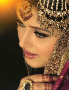 GORGEOUS traditional jewelry worn by a Pakistani bride (this is a real bride) and her makeup, and everything is STUNNING. I love the Kundan ring!