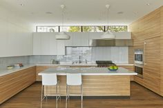 Kitchen with Pleat Box pendant lights and Lio Stools in San Francisco remodel by Studio Vara.