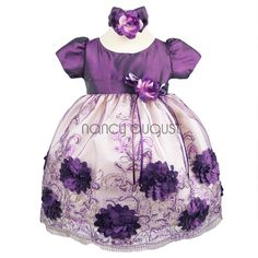 Cutesy Plum Flower Baby Dress with Sequin and Embroidered Tulle Skirt:  The purple baby dress is drenched in sequin and embroidery it's unbelievable. This dress offers a taffeta bodice, a sewn in floral bouquet on the waistline, tulle skirt overlay, a crinoline enhanced skirt and a sensational beaded and embroidered skirt. This dress also comes with a matching purple satin headband and bloomer.