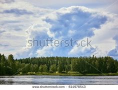 Stock Photo: Majestic thunder clouds forming in the bright summer day sky in Finland. -