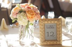 Pink and peach centerpiece   Rustic Elegant Pink and Gold Wedding via TheELD.com
