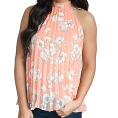 Coral Floral Pleated Top Brand New  Coral Floral Top is so versatile!  The high collar is flattering and chic and the swing style pleats are on trend and perfect for Spring. Wear it causal during the day or dress it up for a night on the town!  * 100% Polyester  No Trades Boutique Brand Tops