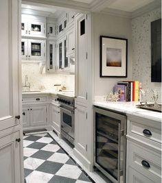 Fabulous small city kitchen. 32' Viking range, grey cabinets, grey and white floor