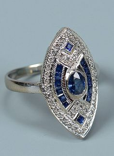 Art Deco18k white gold sapphire and diamond ring with center oval sapphire, ring size 7-1/2, 6.6 grams.