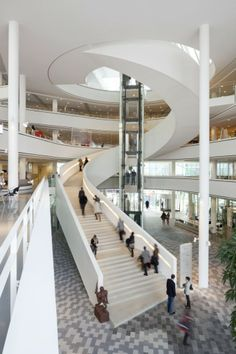 """The five floors spread out like a fan and open up towards the atrium, allowing the building's visitors and employees to visually connect with what is happening on the other floors. The different levels are connected by an open winding staircase. Rotation of the floor plans allows the visitors a wide view from one floor to the next all the way up and down through the building."""