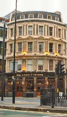 London: The Viaduct Tavern is built upon the site of the Giltspur Street Compter, a sheriff's prison demolished in 1855. In the cellar of this London :Victorian pub are the cells for holding the rogues of the day. As the pub name suggests, The Viaduct Tavern is named after the nearby Holborn Viaduct, both the pub and Viaduct were opened by Queen Victoria in 1869.