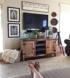 Decorating around tv...something long and narrow above and different height/shape items on either side. I like the basket with blankets too!
