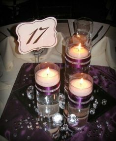 Elegant arrangement with candles on half the tables flowers on the other half