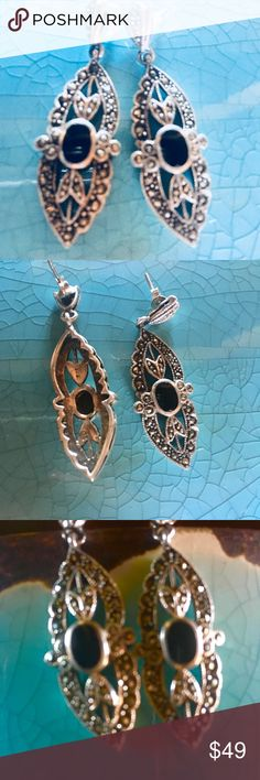 Art Deco Style Black Onyx & Marcasite Earrings These Art Deco Styled Jewels are 1.75 long. Made of Sterling Silver, they are designed with leaves, fans, and scalloped edging. Enhanced with Marcasite & centered with a bezel set 5x7mm Onyx Cabochon. 9.2grams Jewelry Earrings