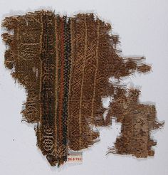 Fragment Date: 5th–6th century Geography: Egypt Culture: Coptic Medium: Wool, linen; plain weave, embroidered (?) Dimensions: 7 15/16 in. high 8 5/16 in. wide (20.2 cm high 21.1 cm wide) Classification: Textiles