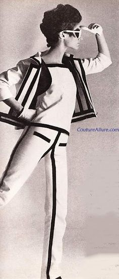 Andres Courreges Pant Suit-1965. White sailcloth pant suit with navy grosgrain ribbons accenting the seams. Note the stripes of ribbon on the inside of the jacket.