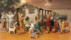 "14 pieces: baby Jesus in manger bed, Mary, Joseph; 3 wise men; 2 shepherds; angel; star; 4 animals, miniature gift chests filled with genuine frankincense, myrrh, and 23-karat gold & lighted stable 15"" x 9.75"" x 4.25""; (batteries included).Jesus can be placed in the manger or held in Mary's arms, figures to 7"" tall; star is 9.75"" $149.99"