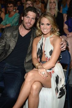 Pin for Later: Carrie Underwood and Mike Fisher Are Already the Most Adorable Parents  The pair stuck close in their seats at the 2014 CMT Music Awards.