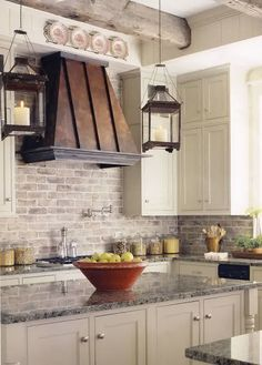 Linda Patton The exposed brick in this kitchen with the copper and textured countertops, wood beams, and pops of cream help to make this kitchen country style without frills and chickens! Description from pinterest.com. I searched for this on bing.com/images