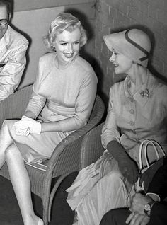Marilyn💋 with Vivian Leigh at a press conference for Marilyn's arrival in  London;1956
