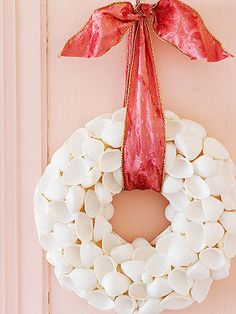 Make a Shell Wreath  -- Instead of stashing away pretty shells collected on beach vacations, make a wreath that looks good anytime of the year but especially so at Christmas. Simply glue shells of varying shapes and sizes to a foam wreath, placing them at random. Finish it with a pretty bow that matches your holiday decorating palette.