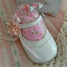 Little shoes into pin cushions
