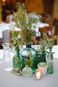 Rustic Wildflower and Vintage Bottle Centerpieces Wedding Bottles, Wedding Vases, Chic Wedding, Wedding Table, Wedding Flowers, Wedding Decorations, Whimsical Wedding Decor, Vintage Centerpiece Wedding, Wildflowers Wedding
