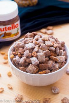 Salted Peanut Nutella Puppy Chow Seriously addicting salty/sweet snack mix made from Nutella, peanuts, and Chex cereal. Recipe is gluten . Snack Mix Recipes, Yummy Snacks, Delicious Desserts, Yummy Food, Snack Mixes, Salty Snacks, Fun Food, Fall Recipes, Dessert Recipes