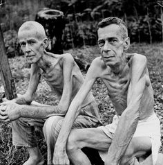 US citizens Lee Rogers and John Todd photographed after being liberated from their civilian internment camp. Both men had been working at the university in Manila when the Japanese invaded, and were interned for the duration of the war.