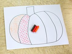 Textured pumpkin using crayon rubbings.