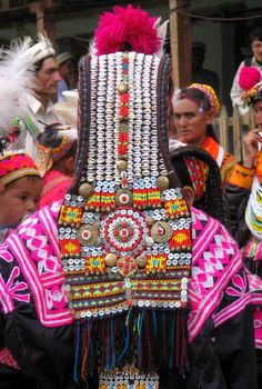 Northern Pakistan | Details of a Kalasha (Kalash) woman's headdress