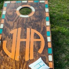 Custom Cornhole boards on the lawn cSt