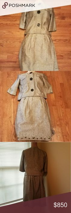 NWOT. GORGEOUS vintage Miichael Kors skirt suit NWOT. PRICE REDUCTION. Michael Kors skirt suit. Can be worn with or without a blouse. Both Top and skirt are fully lined. Top has 3 snaps for closure with 3 large buttons illusion look. Pockets on front of top.  Skirt has pleated waistline with side zipper as well as pockets. Hem of skirt has beauriful hand sewn embellished stones. The back of the top has an area on the seam that looks loose but it is not. Will look retro and stylish in this…