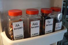 Use old and empty bulk spice containers to organize and easily access household batteries.