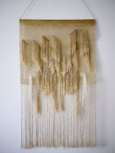 Weaving justine ashbee for native line. Woven gold wall hanging